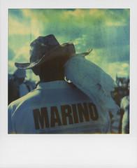 Marino and the Cockatoo, Coney Island (Rhiannon Adam) Tags: usa newyork brooklyn analog square polaroid coneyisland unitedstates american vintagecamera analogue cockatoo cowboyhat bigapple marino timezero expiredfilm polaroidsx70 instantfilm integralfilm