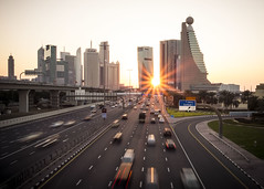 Into the sun (Charn High ISO Low IQ) Tags: sunset highway dubai cityscape traffic uae sunray sheikhzayedroad sunstar highrisebuilding zabeelpark canon6d