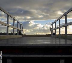 Leading Lines (SimonTHGolfer) Tags: bridge england sky art clouds skyscape landscape wooden suffolk boards nikon fineart walkway rails groundlevel dslr handrails fineartphotography leadinglines drawnin d5100 flickrandroidapp:filter=none