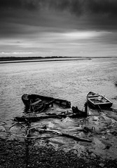 Forgotten (Brannan Photography) Tags: wood sky blackandwhite bw white storm black abandoned broken monochrome stone clouds river mono boat mud sink monochromatic sunk