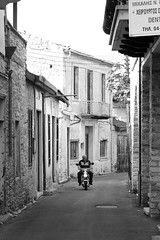 Village transportation (msiapan) Tags: street old bw man monochrome village cyprus scooter larnaca lefkara