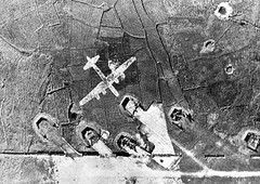 A decoy B-29 so scaled that it appears to be flying, Tien Ho airfield China, March 9, 1945. From a high altitude the decoy gives the illusion of a B-29 in flight with flames streaming from it. The Japanese attempted to lure others to investigate and becom (Histolines) Tags: china from history that fire japanese for march flying high others with altitude flames flight 9 it x retro illusion be timeline 1200 ho attempted 1945 become gives investigate streaming lure airfield 850 tien decoy scaled b29 antiaircraft the appears targets vinatage a historyporn histolines httpifttt1xj2vvn