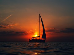 Sailing away (beachbum prints) Tags: sunset ontario canada reflection sailboat spring waves sailing cloudy may greatlakes sarnia lakehuron susnet olympuscamera discoveront inspiredbyhenrys
