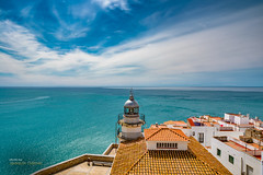 The sea is calling me (Oddiseis) Tags: old blue light sea sky urban lighthouse house window clouds reflections coast spring spain mediterranean village turquoise calm roofs litoral azur cirrus castelln pescola cirrostratus hightclouds valenciancommunity sigma2014art