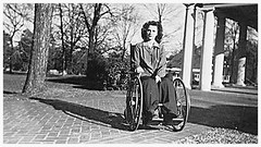 1940s Polio girl in old style wheelchair (jackcast2015) Tags: polio infantileparalysis poliomylitis braces braced calipers handicapped disabledwoman crippledwoman wheelchair