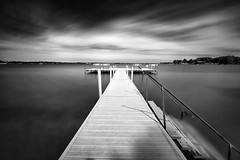 Pier @ Oakwood Resort, Indiana (Michael Mehl) Tags: sky lake water clouds cloud movement white pier monochrome black time dark long exposure indiana usa syracuse oakwood resort