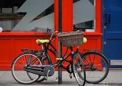 Urban installation (jeremyhughes) Tags: london oldstreet urban composition bicycle bicycles bikes bike red blue locked shopfront city shapes basket nikon d750 80200mmf28d