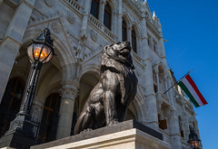 Guardians of Parliament (lncgriffin) Tags: travel art statue architecture zeiss europa europe hungary sony budapest lion parliament magyarorszg hungarianparliament sonnar hungarianflag sonnar35mmf2 rx1r