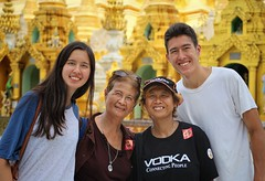 Holiday smiles at Shwedagon Zedi Daw (Bn) Tags: myanmar birma burma yangon rangoon former capitol street candid monk bikes taxi city six million people buddhist temple botataung pagoda botahtaung gautama buddha hair 2500 years old religions locals 40m high seaport dazzling road car gold kyats umbrella sunshine fietstaxi gate entree hollow destroyed rebuild colonial overwhelmed infrastructure slums pilgrims buddism traffic cycling shwedagonpagoda 2600years 99m portrait group 50faves topf50