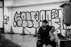 A takoyaki seller old man (halskygene) Tags: old city urban white man black men monochrome japan asian japanese graffiti tokyo asia cityscape east takoyaki cyberpunk