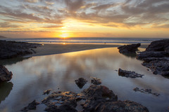 Ahipara Sunset (Joe Nelley) Tags: sunset newzealand beach rocks flickr seagull sharp ahipara canonefs1855mmf3556is absolutelystunningscapes joenelleyphotography