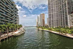 Miami River - Florida (Andrea Moscato) Tags: city blue light shadow sea sky usa white reflection building tree green water clouds america skyscraper boat us downtown day mare waves cityscape view unitedstates walk fiume vivid palm cielo vista acqua civiccenter citt statiuniti andreamoscato