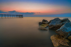 Sea Of Tranquility (Nelepl) Tags: canada water clouds sunrise dawn pier rocks tranquility manitoba matlock calmness lakewinnipeg