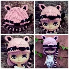 pink bandit raccoon hat