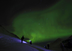 Northern Lights Glow in Iceland (` Toshio ') Tags: longexposure bridge winter people snow cold green nature night stars island iceland europe european nightshot flash northernlights auroraborealis akureyri phenomenon toshio northerniceland