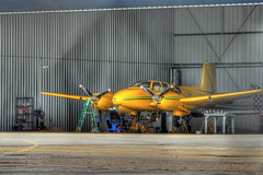 Big Dog's Beech Twin Bonanza undergoing maintenance (V-rider) Tags: painterly yellow airplane photography fly hangar twin ralph cary hdr beech fowler twinengine signed bonanza bigdog cae rhm