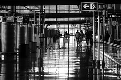 Airport Stories (Madhusudanan Parthasarathy) Tags: madrid street people blackandwhite mono airport spain nikon europe bajaras 55200mm d5100