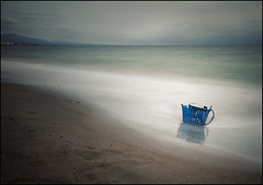 the blue basket (biancavanderwerf) Tags: ocean old travel blue sea mountain holiday abandoned beach broken water landscape spain garbage sand waves basket decay espana nd bianca longshutter