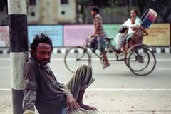 EYES of the Homeless... (Sheikh Shahriar Ahmed) Tags: street portrait film analog 50mm nikon homeless fujifilm addicted dhaka bangladesh minar riksha shaheed vagabond candidportrait nikonf6 af50mmf18d fujicolorc200 dhakadivision ducampus epsonv330 sheikhshahriarahmed