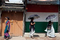 (Life in Frozen Frames) Tags: street woman india umbrella closed indian shops indianwoman lifeinfrozenframes reemagill tamaghnasarkar 20130704dsc0006