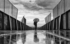 Of Water and Rust (BackOnTrack Studios) Tags: bridge storm water rain clouds umbrella rust sofia poduene