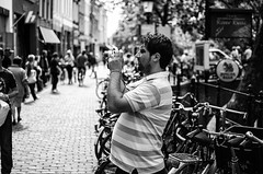 The Photographer, The Photographed (Streetlife) (Mark Kerkhoff; Vagrant Photography) Tags: street camera city people urban bw monochrome 35mm photography blackwhite nikon utrecht photographer candid streetphotography streetlife photographed urbanlife d7000 thephotographerthephotographed