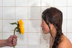 Surprise! (awhelin) Tags: flower water dark hair shower person photography one nikon hand joke profile sunflower surprise prank splash d800 awhelin
