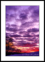 Colorful February Sunrise (travelphotographer2003) Tags: orange usa clouds sunrise purple bright pastel westvirginia redsky february naturalbeauty sunrays shiningthrough brilliance appalachianmountains alleghenymountains beautyinnature webstercounty