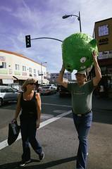 103 (AreEx78) Tags: street old woman man color green birds digital la pig kid los child heart angeles husband angry wife pinata staring ricoh grown grv