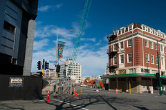 Way Way Up High (Jocey K) Tags: road street newzealand christchurch sky signs architecture buildings shadows crane flags cbd roadcones