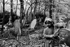 guardian (donvucl) Tags: bw blur london stone gravestones statuette abneyparkcemetery donvucl fujix100s