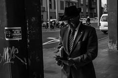 (Rense Haveman) Tags: street blackandwhite bw man monochrome hat sign blackwhite streetphotography tenerife lalaguna rensehaveman fujix100t
