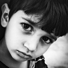 the eyes of innocence (mare_maris (very slow)) Tags: world poverty family boy portrait blackandwhite pope monochrome face hope kid eyes war peace dof child humanity outdoor refugees homeless working handsome ears nios lips kind greece solidarity ojos unitednations innocence staring enfant wondering citizen nio glance better humanitarian feelings garon  ragazzo bambino archbishop profughi migrants muchacho refugiados flchtlinge   unchr withoutshelter rfugis    ieronymos  migrantcrisis popefrancis workingtowardsabetterworld  theeyesofchildren occhideibambini lesyeuxdesenfants junge augenderkinder