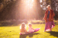 Sunlit Spring sliding... (Marla Nutbrown) Tags: family sun sunlight sisters outdoors spring rays sled naturallightphotography marlanutbrownphotography