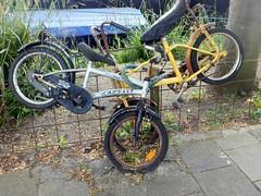 Collision (Quetzalcoatl002) Tags: street old rusty bikes discarded collision geparkeerd fietsjes childrensbikes