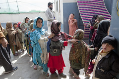 Feed time in drop-in-centre 0283 (shahidul001) Tags: girls pakistan boy food color colour boys students girl horizontal kids children daylight compound kid student asia day child refugee refugees homeless line queue pakistani learner drik southasia quetta learners dropincentre balochistan drikimages