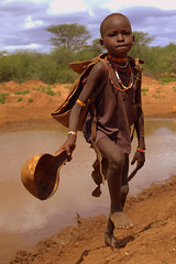 Fetching water (Rood zand) Tags: africa water girl child south tribal valley ethiopia tribe ethnic collecting fetching omo omorate ethiopi
