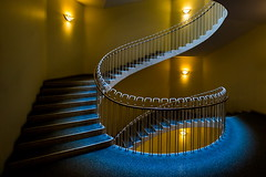 Serpent (Maerten Prins) Tags: blue light orange yellow stairs copenhagen dark spiral denmark curves stairwell staircase railing kopenhagen balustrade denemarken gyldenlovesgade15