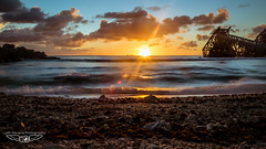 Tropical Sunset lens Flare (laith_stevens) Tags: ocean longexposure sunset sea clouds island movement olympus lensflare flare tropical zuiko sunflare nauru freightship skyporn goneawol olympusinspired