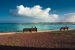 writing postcards with sunglasses (maulbeerbaum) Tags: blue sea sky cloud beach strand bench bay meer wasser himmel wolke wolken bank blau abendsonne bucht corralejo fuerte dunkelblau