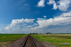 Failed Storms (kevin-palmer) Tags: railroad blue sky white green field grass weather clouds illinois spring track afternoon north may farmland cumulus dunlap anvil circularpolarizer cumulonimbus 2016 tamron2470mmf28 nikond750