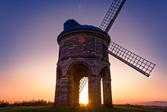 Chesterton Windmill (davidwharwood) Tags: uk morning blue shadow red sky orange cloud sun green tower english mill windmill stone sunrise golden countryside early arch wind farm hill farming landmark cotswolds sail chesterton warwickshire hilltop sunup chestertonwindmill