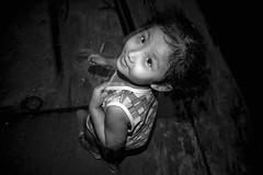 It's in the eyes - 02 B&W (-clicking-) Tags: life blackandwhite bw cute monochrome childhood children blackwhite eyes child streetphotography streetportrait streetlife monotone vietnam dailylife lovely childish childlike nocolors vietnamesechildren