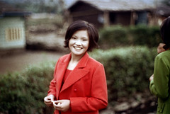 32-057 (ndpa / s. lundeen, archivist) Tags: nick dewolf nickdewolf 32 reel32 color photographbynickdewolf 1970s 1972 fall film 35mm winter republicofchina taiwan taiwanese eastcoast easterntaiwan hualien hualiencounty easterncoast village rural blurry outoffocus nd people woman youngwoman guide localguide red clothes clothing face smile smiling buildings houses homes china chinese blur 1973