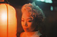 Lantern Glow (Jon Siegel) Tags: city light urban woman film girl beautiful japan mystery night japanese 50mm tokyo evening nikon shinjuku glow magic details mysterious 12 filmcamera nikkor wandering secrets fe2 nikon50mmf12 nikkor50mmf12ais cinestill