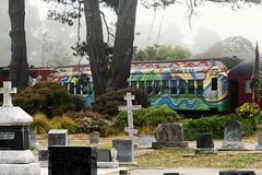Rainbow Soul Train (sarahellenspringer) Tags: windows cemetery graveyard fog train rainbow colorful cross transportation