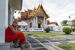 Empty gaze (tapanuth) Tags: travel people orange tourism architecture thailand religious temple design bangkok buddhist religion monk landmark historic monastery cape marble wat attraction novice cloack practioner benjamabophit