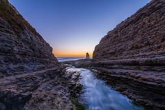 Sunset through the crevice, Davenport (anishsid) Tags: california sunset beach landscape davenport pacificcoast crevice 1424mm 140240mmf28