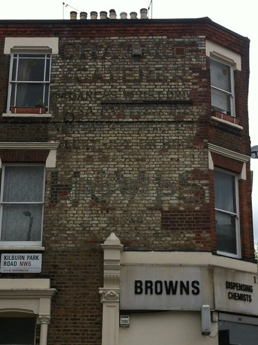 Ghost sign in Kilburn Park Road, London NW6.