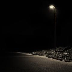 Mono Street Light (Gikon) Tags: longexposure light urban bw monochrome night 35mm dark mono nikon streetlight nightshot streetlamp streetphotography simplicity simple urbanphotography 35mmf18 gikon d3100